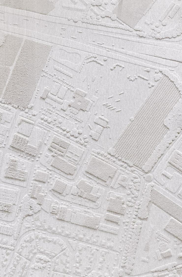 Wollen vloerkleed van Christien Meindertsma toont maakproces van schaap tot tuft-robot